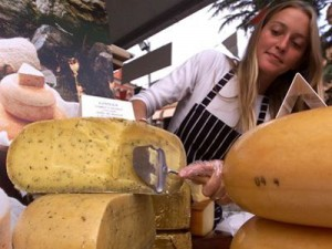 wheel of cheese being cut in Piedmont