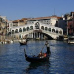 Gondolier riding in Venice