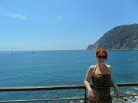 Cinzia posing in front of the water/ocean
