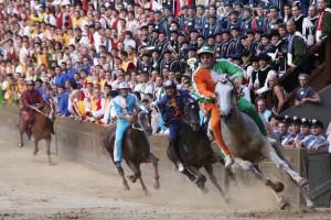 jockeys racing horses in Siena's Palio