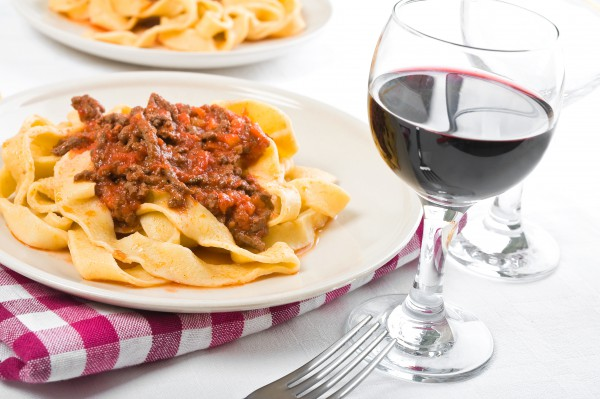 Pasta and wine are never missing from Italian kitchen tables