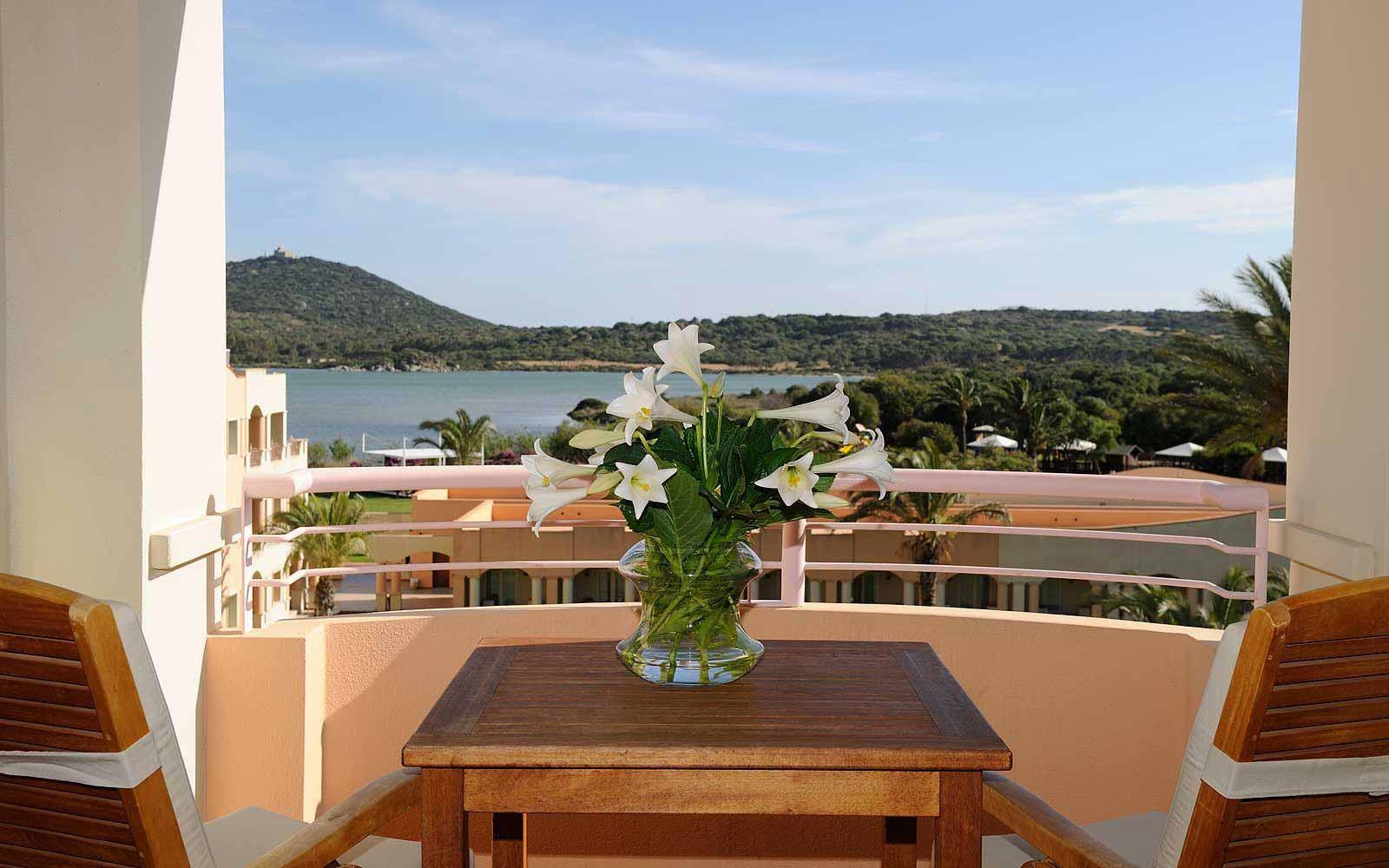 Balcony in a Bayside Room at Pullman Timi Ama Sardegna