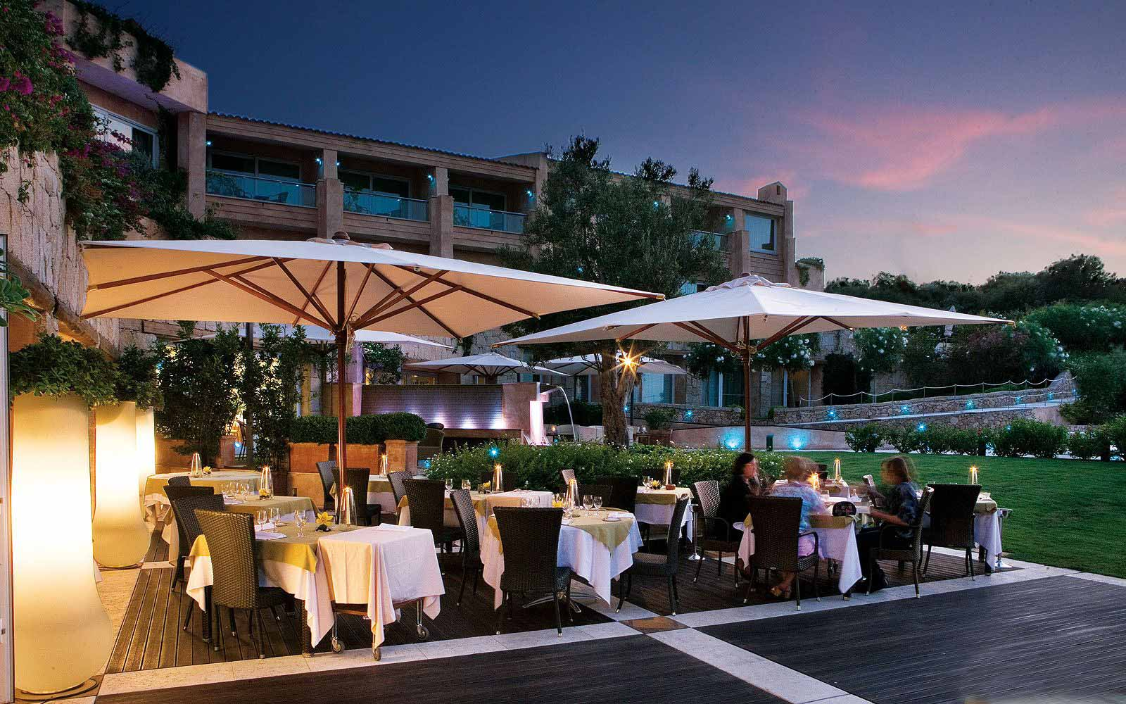 Outdoor dining at the L'Ea Bianca Luxury Resort