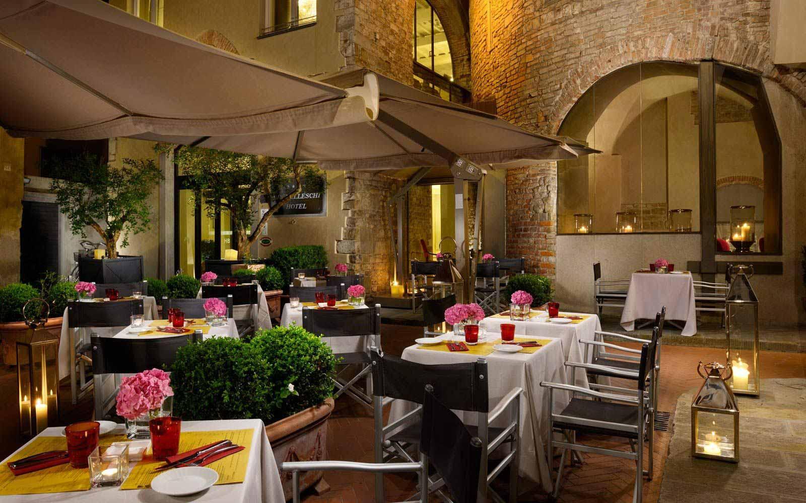 Outdoor area of the Osteria della Pagliazza restaurant at Hotel Brunelleschi