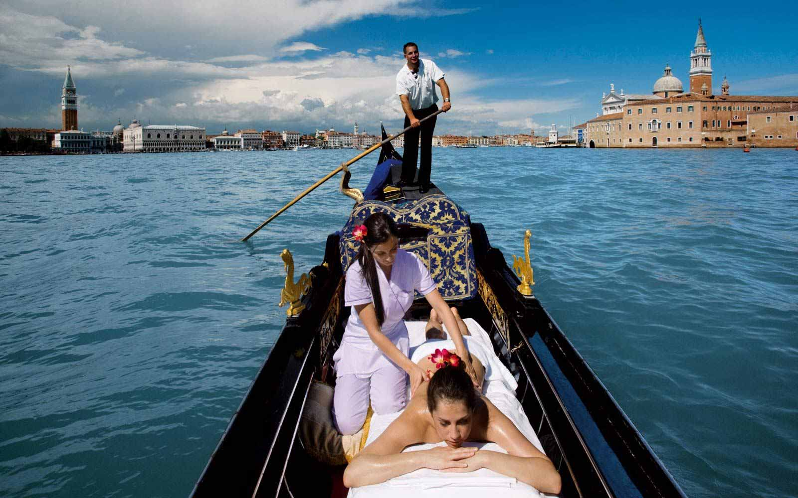 Relaxing massage on a gondola at Belmond Hotel Cipriani