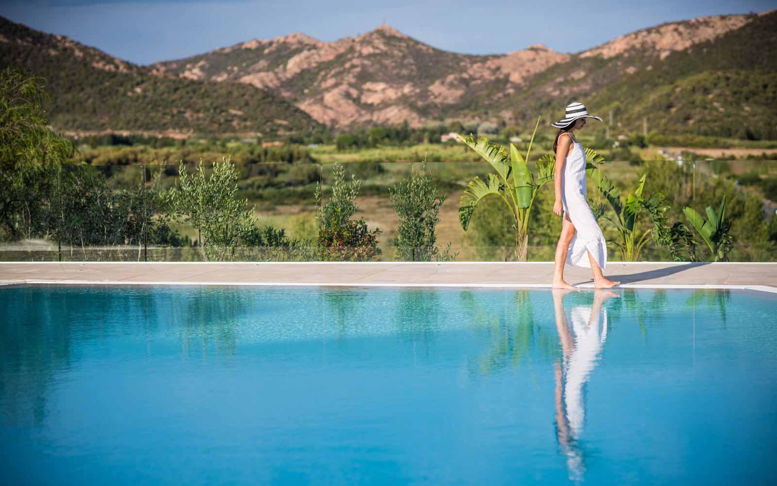 Pool with view at Chia Laguna Resort