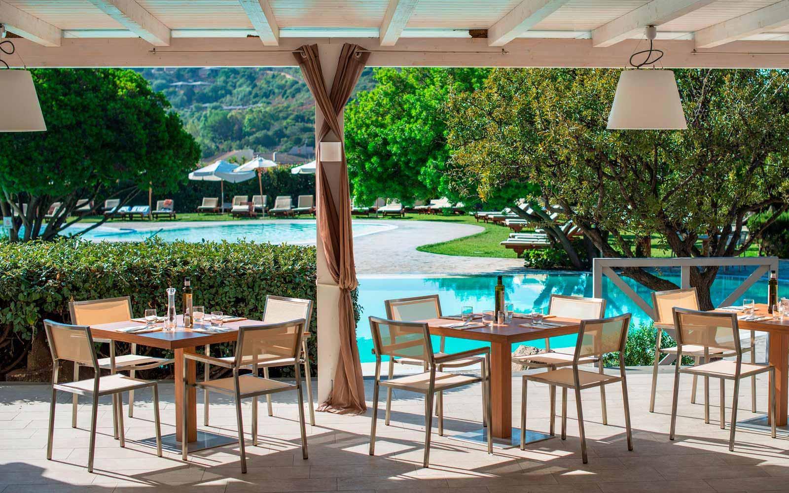 Club house pool Restaurant at the Chia Laguna Resort
