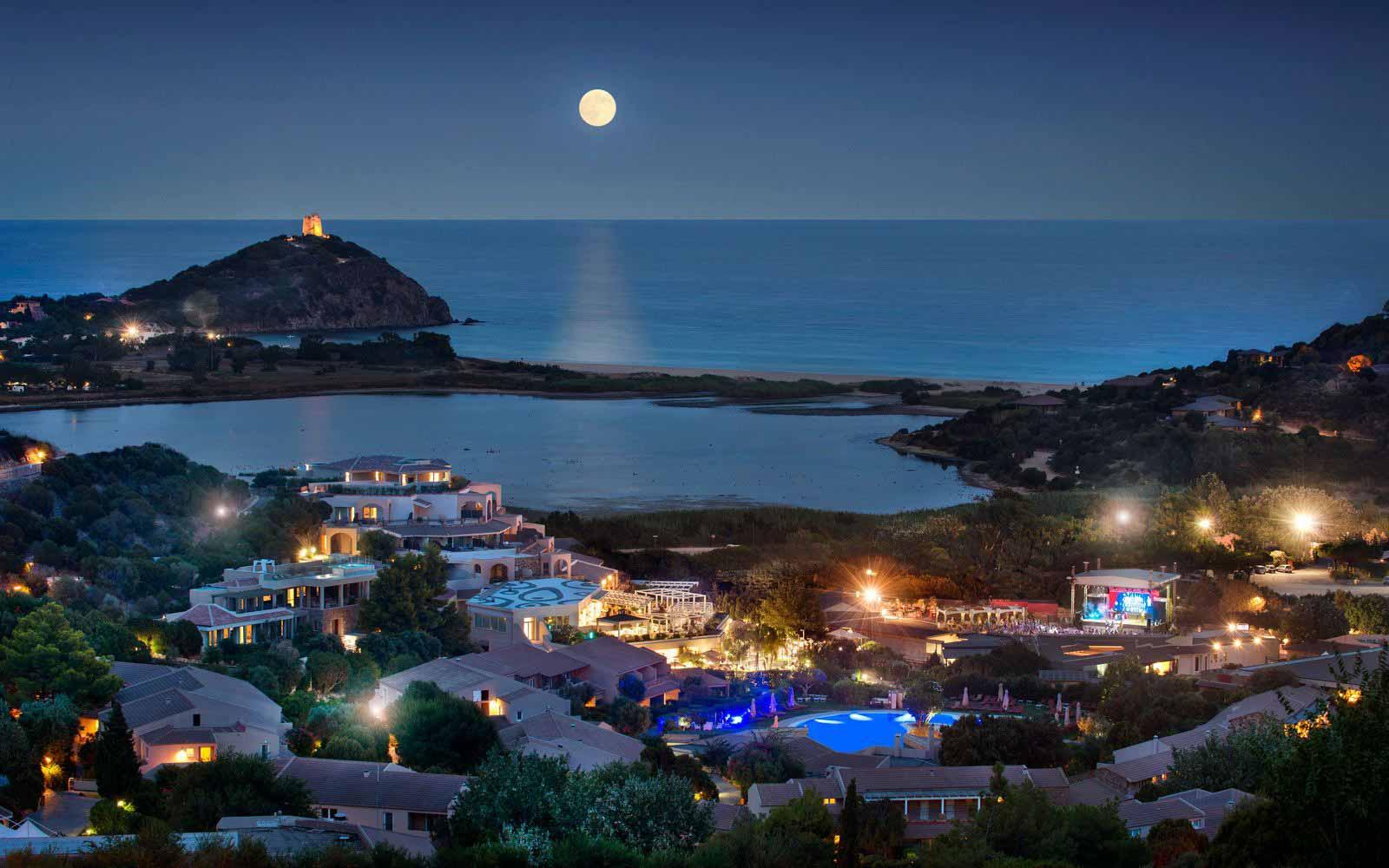 Chia Laguna Resort at night