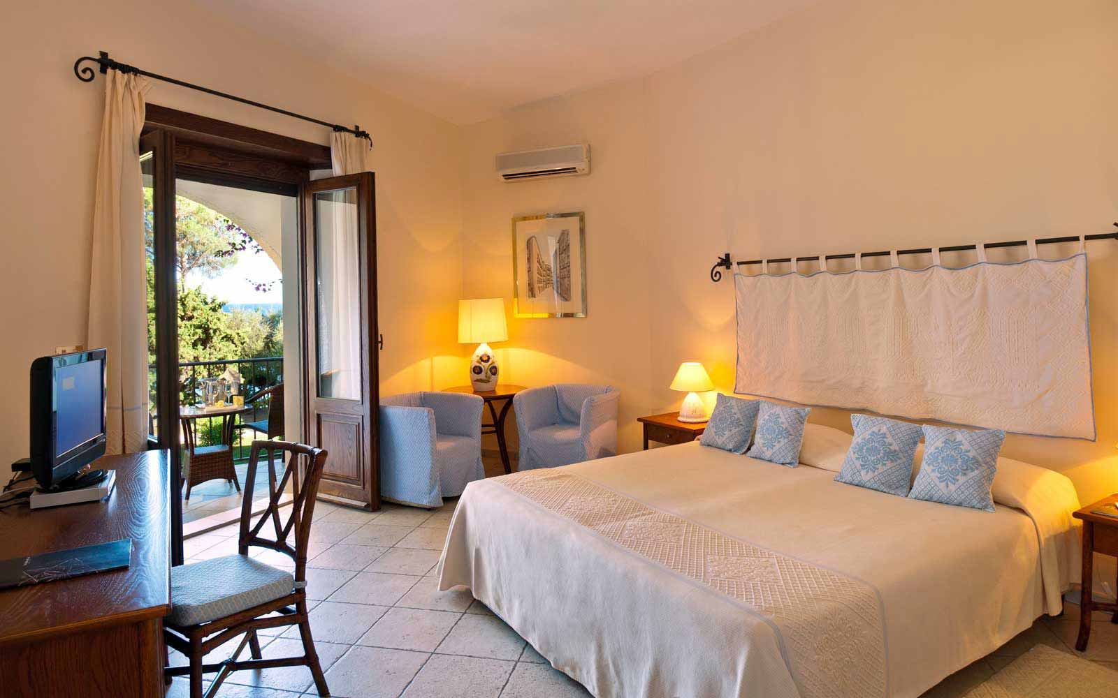 Deluxe seaside room at Is Morus Relais