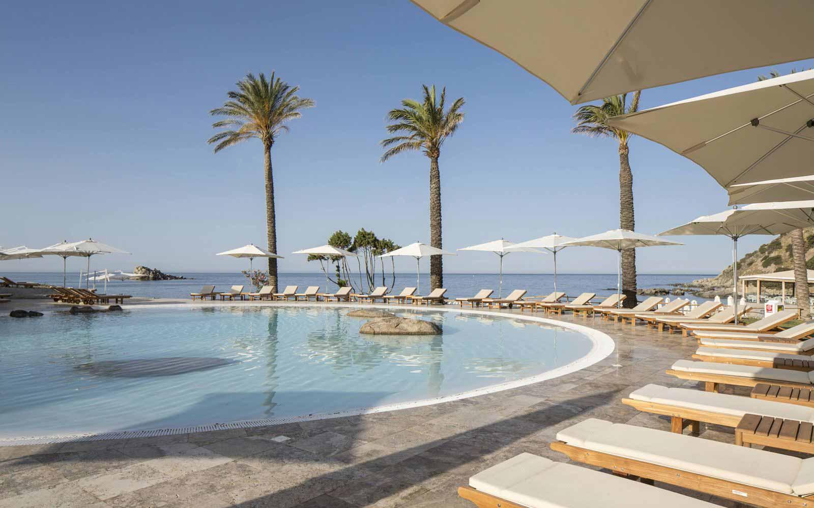Swimming pool and solarium at Capo Boi Resort