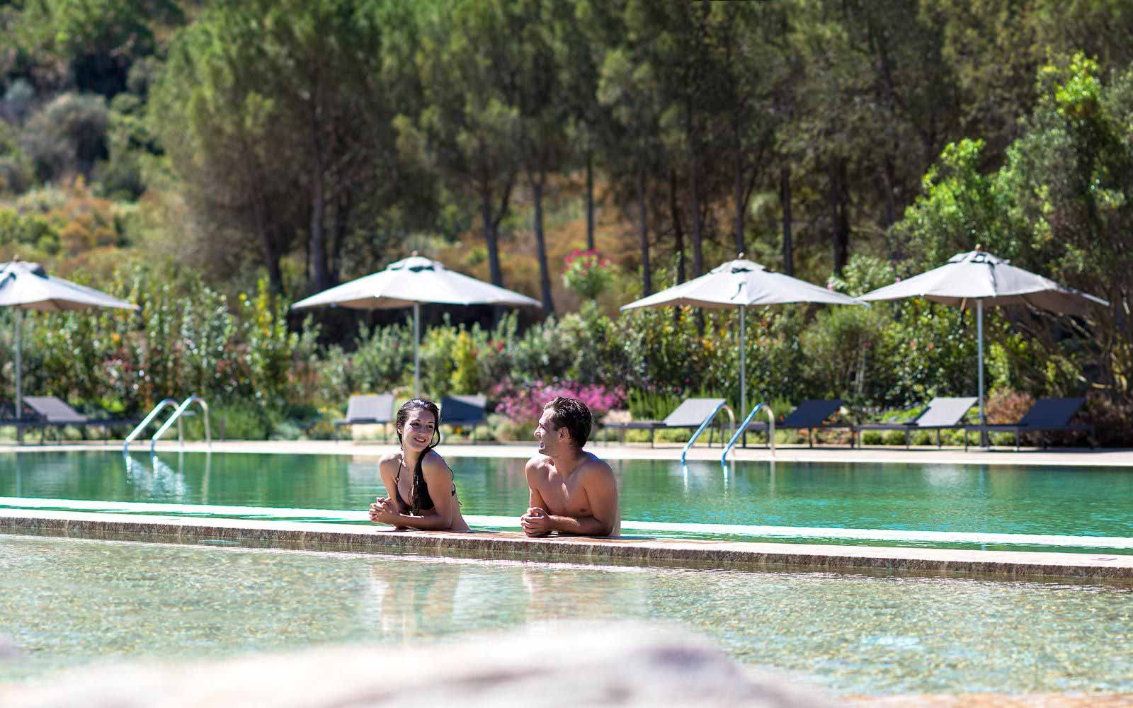 Relax at the poolside at Chia Laguna Resort Hotel Baia