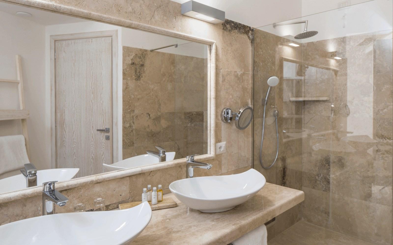 Suite Bathroom at Capo Boi Resort